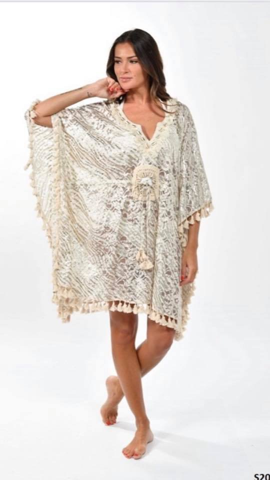One size fits all tassel poncho